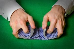 Hands shuffling cards in casino