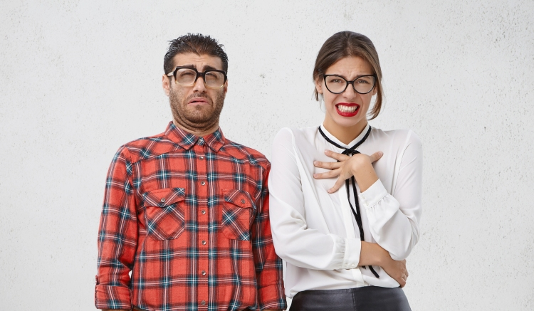 Unhappy Discontent Woman And Man Look With Disgusting Expression