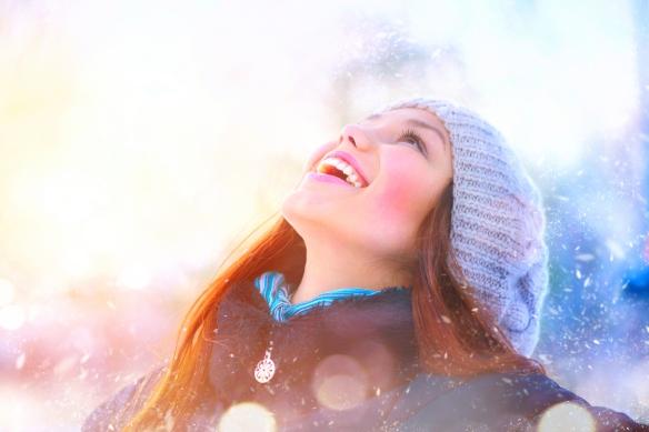 Winter young woman portrait. Beauty Joyful Model Girl raising ha
