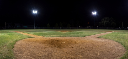 Panorama Of Empty Baseball Field At Night From Behind Home Pate
