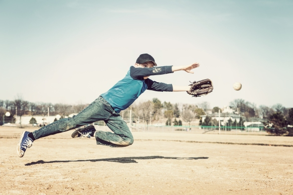 bigstock-Boy-leaping-to-catch-a-basebal-87082937.jpg