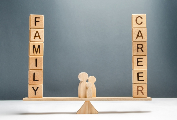 Family Figures Stand On Scales Between Career And Family. Concep