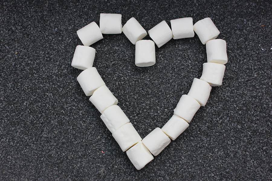 Marshmallows Laid Out In The Shape Of A Heart Isolated On A Gray